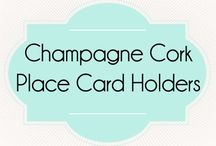 Champagne Cork Place Card Holders / Find these unique cork place card/escort card holders at corkeycreations.com.
