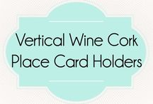 Vertical Wine Cork Place Card Holders / Find these unique cork place card/escort card holders at corkeycreations.com.