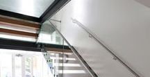 Staircases with open risers and glass landings.
