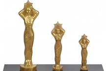 Chocolate Award Statues / Made with our exceptional all-natural chocolate, these statues are great for Academy Award® parties - for the best dressed attendee or most winners picked or any other entertaining category. The chocolate Oscars® are perfect for friends or relatives that are celebrating a special occasion or accomplishment. This fun edible gift can also be used as a thank you gift for your favorite teacher or coach.