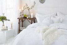 White <soft> / Smaller guest room  ; fresh + breezy + soft  ; peonies, wildflower sprigs  ; wooden accents, nature  ; cozy, comfy, plush  ; wooden photo frames, candles  ; single long bench with candles, blankets, soft furry fabrics  ; fur rug