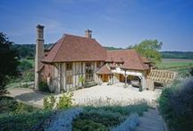 Wealden Farmhouse / A classic Wealden style new-build farmhouse nestled in a valley overlooking the beautiful Kent countryside, in an area of outstanding natural beauty. Down to its oak frame, colourful Belgian brick chimneys and careful landscape, it has a storybook magic.