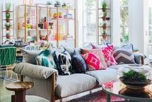 Lovely Living Rooms / Living room inspiration from across the world. Bright cushions, aztec prints, comfy sofas, subtle lighting, iconic chairs and stunning rugs - what's not to like!