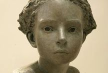Representational sculpture and doll
