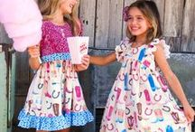 County Fair / Swing your partner 'round and 'round the County Fair is comin' to town! It's sure to be a good time with fun cowgirl prints and styles as sweet as funnel cake!