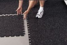 Home Gym Ideas / Gym floors come in a variety of styles and materials. We know it can be confusing when trying to choose the correct flooring for your particular gym floor mat needs. With interlocking rubber flooring tiles or rubber rolls in dozens of color options.. We have something you are sure to love! / by RubberFlooringInc