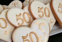 50th anniversary corporate dinner / 50th anniversary corporate gala.  Colours requested: blue, white, yellow, grey Centerpieces must include tulips Simple, elegant