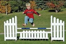 Kid Jumps / Horse jumps built just for kids. Lightweight, stable jumps with color options and printed graphics. Accessories like mini jumping poles, walls, coops, gates, and flower boxes.