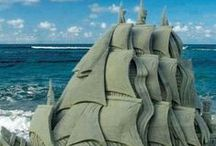 Sand Art / Sand art is the practice of modelling sand into an artistic form, such as a sand brushing, sand sculpture, sandpainting, or sand bottles. A sand castle is a type of sand sculpture resembling a miniature building, often a castle. (via Wikipedia)