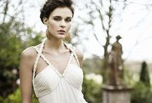 Grecian   Wedding Inspiration / Feel like a goddess on your special day with a Grecian-inspired wedding. There are many ways to host a modern wedding by incorporating the ancient Grecian elements. The colour scheme would consist of gold, ivory, olive green & off-white. Dress the part in a softly draped wedding gown with gold trimmings & a leafy crown. Use Grecian columns & a few Greek statues to create a Grecian ambiance. Add olive branches to your bouquet, wedding cake, invitations and table decor to finish off the look.
