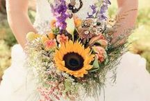 Sunshine   Wedding Inspiration / We absolutely love these big, bright, beautiful blooms! Sunflowers make a happy statement on a bride's most joyous day. When used with burlap, driftwood and raffia, sunflowers aid to create a rustic, country wedding theme. For a more modern look, opt for a black and white colour scheme with accents of glass such as clear mason jars. Acres and acres of sunflower fields also make for a beautiful backdrop for wedding and engagement shoots.