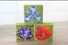 Block Art / Blossom Blocks are beautifully painted flowers on stackable wood blocks. Each flower's meaning, found on the bottom of the block, is paired with a corresponding Bible verse. Mix-and-Match flowers to create a personalized floral arrangement with meaning.Example: Pair the Iris, the Poppy, and the Gladiola and you'll have a combination of Hope, Comfort, and Strength.