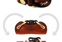 Key Holder / This compact key holder is designed from high quality vegetable tanned saddle leather that is hand died and edge burnished. The unique design of the key holder is comfortable for the palm of your hand but is small enough to fit into any pocket. The key holder holds up to 4 common household keys that can either be secured, or swivel out at your convenience. The hardware used on this product consists of an industrial strength snap, rivet, and cast D ring. This all insures the product's longevity.