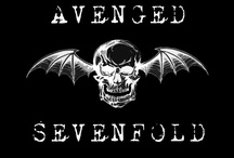 """Avenged Sevenfold / All About My Favorite Band """"Avenged Sevenfold"""" All Members have Stage names that they go by M. Shadows (Matthew Sanders)- Vocalist; Synyster Gates (Brian Haner)- Lead Guitar; Zacky Vengence (Zachary Baker)- Guitar; Johnny Christ (Jonathan Seward)- Bass; The Rev -aka The Reverend Tholomew Plague (James Sullivan)- Drums: Sadly Passed away in December 2009. I've seen them many times and have met M. Shadows and got his autograph. Stupid me, didn't bring a camera."""