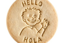 Hello - Hola / At Dick & Jane Baking Company, we have successfully combined whole grain nutrition and education into our new line of healthy, nut free, educational snacks.