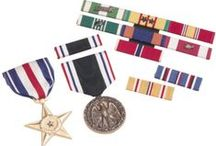 Award Medals / Whether it's a military medal for that honored veteran, or a custom medal for a baseball champion, Lou Scalia's Awards offers a huge selection in award medals. From gold and silver to full color finishes, you can choose either a premade design or we can engrave your text and logo on a custom medal. If you are looking for that extra special bling, we can even add rhinestones. Every medal comes with a neck ribbon in your choice of color (solid, striped or patterned.) www.louscalias.com