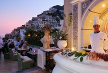Champagne & Oyster Bar / Our Champagne & Oyster Bar enjoys breathtaking views over Positano. It is sumptuously furnished and lit by candles. Open only in the evenings from mid-May to mid-October, weather permitting, it is the ideal place for a drink before dinner, should you wish to savour a glass of champagne millésimé or a cocktail, made to perfection. It is also a restaurant, serving oysters, shellfish, raw fish and other delicacies, accompanied by music selected by our dj Alfonso.