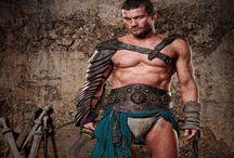Starz Spartacus / Spartacus ist eine Fernsehserie des amerikanischen Kabelsenders Starz, die am 22. Januar 2010 startete.[1] Unter Berücksichtigung der wenigen gesicherten historischen Grundlagen zeichnet sie eine fiktive Lebensgeschichte des thrakischen Gladiators Spartacus (in der ersten Staffel gespielt von Andy Whitfield, danach von Liam McIntyre), der von 73 bis 71 v. Chr. einen nach ihm benannten Sklavenaufstand gegen die römische Republik führte. Sie beschäftigt sich mit dem nur in wenigen Fragmenten überlieferten früheren Leben von Spartacus,[2] seinem Aufstieg zu einem der besten Gladiatoren Capuas und der anschließenden Revolte gegen Rom. Produzenten der Serie sind Steven S. DeKnight, der zugleich Hauptdrehbuchschreiber ist, Robert Tapert und Sam Raimi. Die meisten Folgen der Serie (außer der sechsten[3]) erhielten wegen der Darstellung von Gewalt, expliziten sexuellen Inhalten und grober Sprache eine Altersfreigabe ab 18 Jahren.