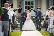 michaela and orion - buxted park hotel - June 2016 / featuring a bouquet of gorgeous pink peonies (Sarah Bernhard), with the addition of some silver senecio foliage around the edge, to frame the peonies.  A frame of roses and flowers as a backdrop for the ceremony/registrars table-plus a guard of honour on the lawn for the happy couple - many congratulations! pictures by david fenwick photography www.davidfenwick.co.uk flowers and venue styling by pollen and pollen4hire www.pollenflowers.co.uk www.pollen4hire.co.uk