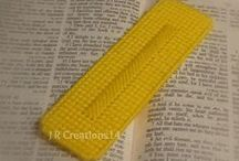 Bookmarks / Made using plastic canvas and yarn. Found in etsy shop at www.jrcreations14.etsy.com / by Rhonda Carter