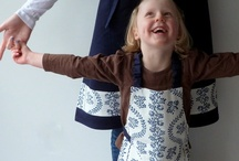 Parent Child Apron Sets / Each child apron's main fabric is echoed in the adult apron's trim. Adult aprons have adjustable neck straps, and child aprons can be put on independently. They make wonderful Mother's and Father's Day presents!