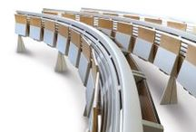 Runner / Integrated and continuous system of seats and tables for university, lecture halls and conference halls, designed and created using new-concept structural layouts, which simplify assembly operations by allowing a wide range of compositional possibilities. Rows are assembled in a continuous form that is made to measure, following precise design requirements: in a straight line, curved or S-shaped composition, on horizontal flooring or on large steps.