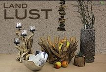 Landlust / In unserem Thema Landlust haben wir für Sie Deko und Wohnaccessoires aus Holz und Metall zusammengestellt. Mit einer Holzschale aus Team, einer Glasvase in Alu - Gewebe eingefasst. Oder ein Leuchter.