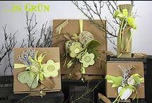 Schöner Schenken ... in Grün. / Schöner Schenken mit fertig dekorierten Geschenkekartons und Getränkehülsen in verschiedenen Grün - Töne gehalten. Mit farblich abgestimmten Akzente. Geliefert wie abgebildet.