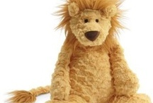 Sleek Stuffed Lions / While hugging a real one is a lifetime dream of mine, at least anyone can hug one of these!