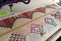 Quilt Borders / Quilts framed with handsome borders always intrigue me. Here I gather the best examples of pieced, appliqued, and quilted borders that I can find. I add commentary to point out why the border works. / by Quilting With Judy Martin