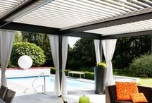 The Solisysteme Bioclimatic Pergola- Residential / The Bioclimatic pergola is a one-of-a-kind, innovative pergola system that was designed to transform and expand outdoor living space in all types of weather conditions. With its aluminum louvers, the Bioclimatic pergola allows you to instantly adjust to sunlight fluctuations and create ventilation in hot temperatures. It also provides protection from cold, rain, snow and wind, and it is also adaptable to any kind of architectural configuration.