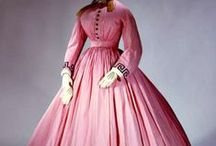 Shades of Victorian Fashion: Pretty in 19th Century Pink / During the Victorian era, pink was considered a sweet, feminine color, suitable for the gowns of young ladies in their first season.  It was also fashionable for more mature Victorian women, who often wore evening dresses made of fine pink satins and silks.  Most commonly of all, pink was an accent color used for trim and accessories, such as bonnets, fans, and parasols.