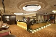 SKYCITY Auckland Casino - Project / SKYCITY Auckland Casino welcomes its guests in bar rooms with three Ugolino system circular lamps. Supplied by ECC Lighting & Furniture.