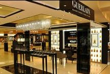 Guerlain Store Dubai Airport / A combination of two Ariel 200 #chandeliers, one with chains of grey #crystal and the other transparent, brights out at the Guerlain boutique in the airport of #Dubai.