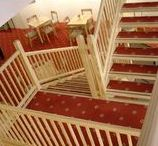 Pine and other softwood stairs and staircases / Softwoods are usually less expensive than hardwoods, but can still look stunning. They can be stained, varnished or waxed to maintain the natural grain and texture of the wood, or you can paint and carpet them to add some extra colour and texure.