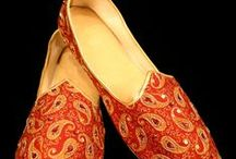 Mojari/ Khussa / Mojari or Khussa is a style of South Asian handcrafted footwear produced in North India and Pakistan. Mojari are made by artisans mostly using vegetable-tanned leather. The uppers are made of one piece of leather or textile embroidered and embellished with brass nails, mirrors, bells and ceramic beads.