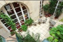 The lovely courtyard of the Millesime Hotel / Discover our little courtyard, a very nice place to enjoy a breakfast in summer or even a drink!
