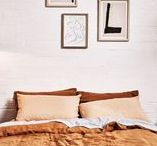 Bedrooms / Everything we love about bedrooms: Linen sheets, bedside tables and comfy beds.