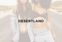 Desertland / Escape to Desertland with Onepiece. Layers of black, blue, and grey build the perfect warm-weather-winter palate. Our midseason lookbook shot by Nicole Pagan in the LA desert features the Distance Jumpsuit, the Air Jumpsuit, Out Zip Hoodie and Out Pant, Solid Hipster, Realize Vest, Horisont Pant, Orbit Pant, Perino Beanie, Raw Beanie