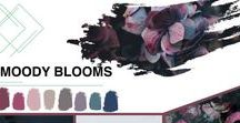 """Floral Design Trend 2018: Moody Blooms / """"Moody Blooms is inspired by the romantic melancholy of dark and saturated hues,"""" according to Kristine Kratt, AIFD, PFCI of Schaffer Designs.   This dramatic palette evokes feelings of comfort with a soothing darkness that calms and warms the soul.  Moody Blooms is a fashion-forward trend adding beauty and elegance with deep, rich colors and decorative furnishings. It combines """"opulent"""" textures and florally elements with loosely gathered florals and opened blossoms."""