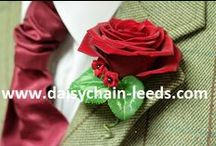 Buttonholes, boutonnières & corsages / Elegant, funky, simple... whatever you want, we will make. Lots of ideas for lapel decoration.  Wrist corsages & handbag corsages also available. We've even done shoes, dogs, teddybears, horses. Lots of white rose images, but then we are based in good old Yorkshire!