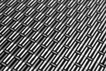 Woven Mesh Aluminum Finishes / Exacting metal finishes synthesize precision and purity.  Stainless steel woven wire mesh and cloth inspiration.  Brushed aluminum in satin black, coarse brush and warm tinted grey.