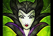 """DISNEY MALEFICENT SLEEPING BEAUTY / Maleficent is the 2014 Disney movie that tells the tale of a wicked fairy godmother who is one of Disney's most beloved villains.  Maleficent was originally crafted on the traditional images we have of witches and hags but evolved to become more elegant than that.  Angelina Jolie who plays Maleficent says she is """"on fire and very aggressive about defending her land.""""  We have known her since Disney released Sleeping Beauty in 1959 but we have never known her back story."""