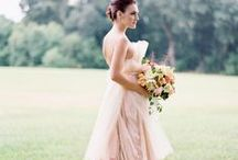 Blushing Brides / Frocks loves simple, classic gowns with a touch of whimsy! With our designers you will find the bridal gown you always imagined, or fall in love with the dress you never knew you wanted!