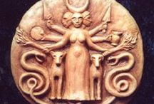 Hecate's Wheel / Hecate or Hekate (/ˈhɛkətiː, ˈhɛkɪt/; Greek Ἑκάτη, Hekátē) is a goddess in Greek religion and mythology, most often shown holding two torches or a key and in later periods depicted in triple form. She was variously associated with crossroads, entrance-ways, dogs, light, the moon, magic, witchcraft, knowledge of herbs and poisonous plants, ghosts, necromancy, and sorcery...