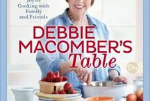 My New Cookbook - Debbie Macomber's Table / Debbie Macomber invites readers and cooks of all stripes into her kitchen, where food is both a blessing and a gift. Featuring 100 delicious recipes she cooks for her own family, including some inspired by scenes from her beloved novels such as the Rose Harbor series.