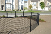 Chain Link Fence / Chain link fence is not just galvanized anymore - available in vinyl coated black, brown and green, with black being the most popular.