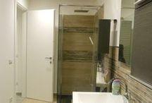 Progetto Bagno e lavanderia / In un appartamento degli anni '60, con una distribuzione irrazionale degli spazi, i bagni sono stati completamente ridisegnati per rispondere alle moderne esigenze abitative di una coppia con una bambina. (Bathrooms and Laundry)