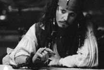 "jackie / Character Jack Sparrow from the franchise ""Pirates of the Caribbean""."