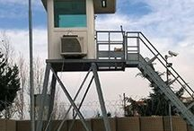 Guard Towers in ballistic steel / High ballistic and blast resistance performance. Each structure isproduced according to the client's specifications, with customized levels of blast and ballistic resistance. Exceptional field of observation and firing range. Ideal solution for perimeter defense at military installations,border crossings, chemical-petroleum plants and industrial locations.